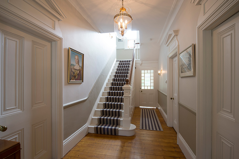 traditional hallway interior, Nikkirees.com, Lighting design, striped staircase carpet, Interior designer wimbledon