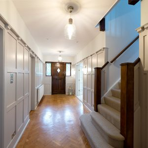Arts and crafts hallway renovation, NikkiRees.com, grey painted wooden panelled hallway, interior designer wimbledon london surrey