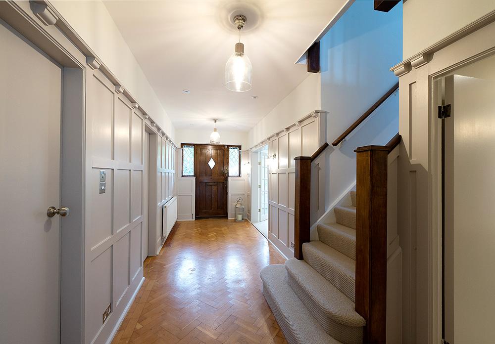 Arts and crafts hallway renovation, NikkiRees.com, grey painted wooden panelled hallway, interior designer wimbledon london surrey