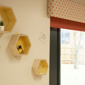 11-Decorcafe-nikki-rees-childbase-partnership-nursery-bumble-bee-honeycomb-storge-boxes